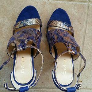 Bebe Blue and gold snake skin high heels